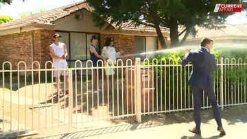 Reporter gets the hose in confrontation with 'hellish' neighbours