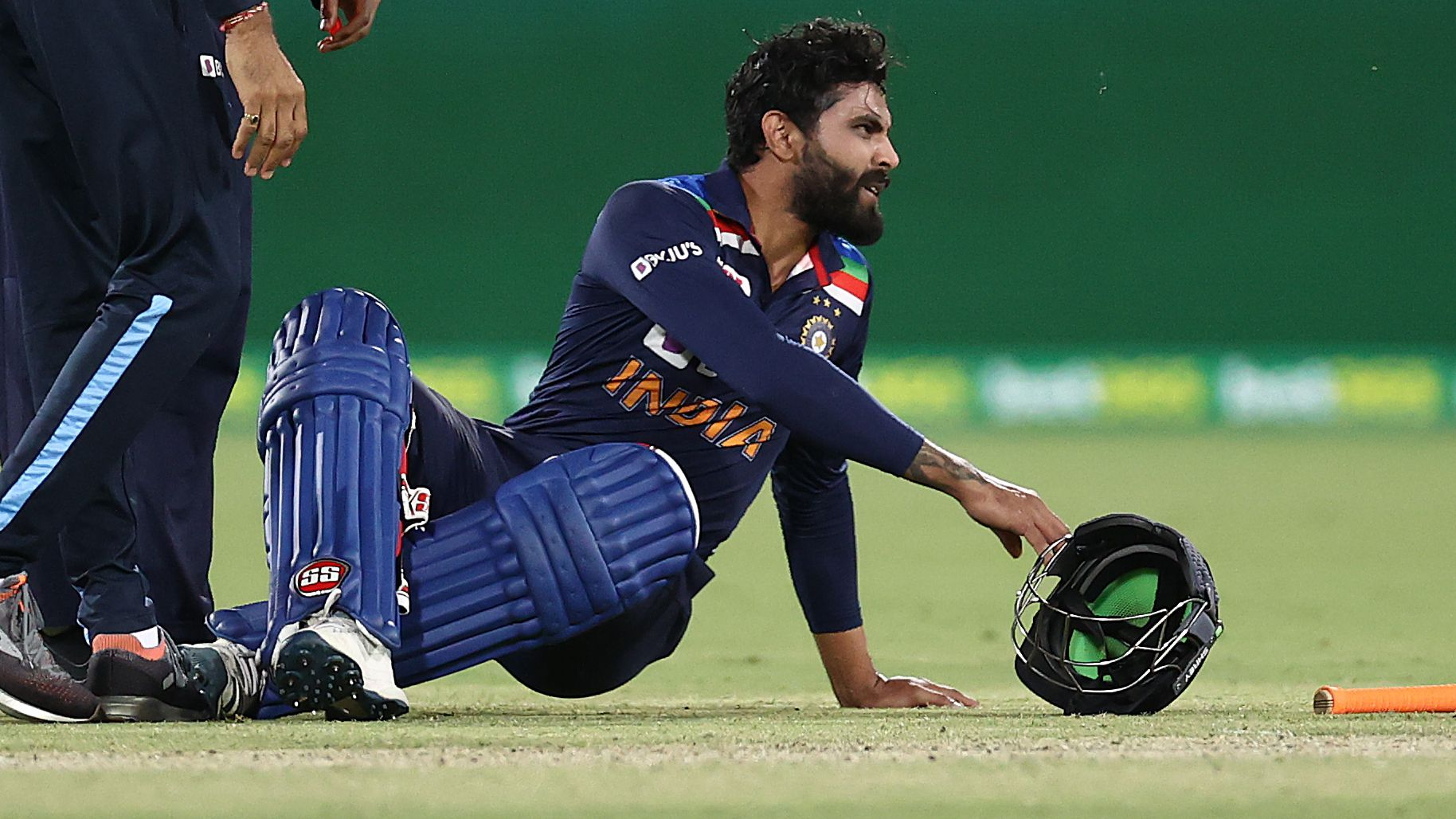 Ravindra Jadeja of India reacts after injuring his leg.