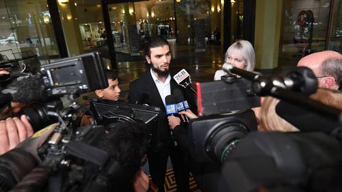 Moudasser Taleb speaks to the media outside Downing Centre Court in Sydney.