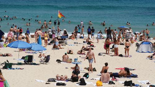 Beachgoers are see at Bondi Beach in Sydney during a major heatwave in January.