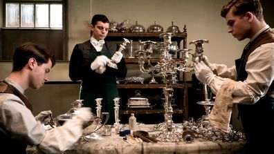 Downton Abbey the movie - valets polishing silver in the house