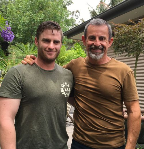 Horne, pictured with his son, was in his car when Murray Deakin attacked.