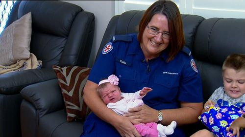 Triple Zero call taker Kylie Crebbert reunited with the baby girl she helped deliver over the phone (9NEWS)