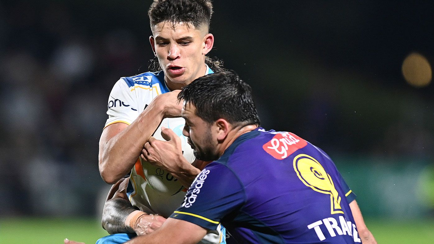 Jayden Campbell of the Titans is tackled by Brandon Smith of the Storm during the round 13 NRL match between the Melbourne Storm and the Gold Coast Titans at Sunshine Coast Stadium.
