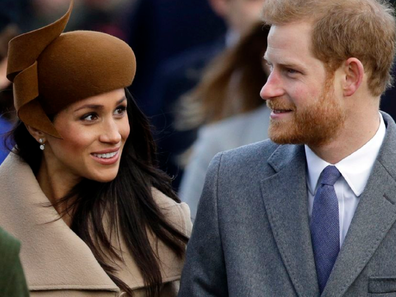Meghan and Harry waling smiling