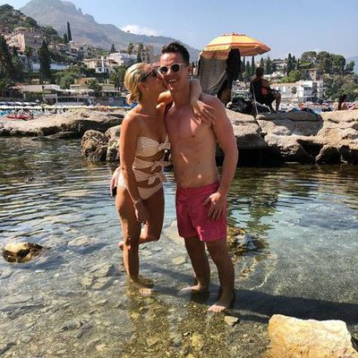 Roxy Jacenko in a swimsuit from American-born stylist turned designer  Lisa Marie Fernandez with husband Oliver Curtis