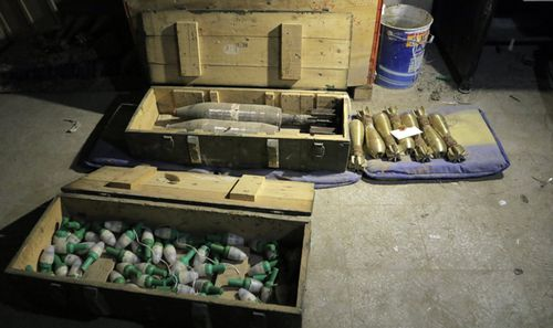 Ammunition allegedly left by rebels in an underground tunnel that was discovered in the recently-captured Jobar town, in the Eastern Ghouta, in the countryside of Damascus, Syria. (AAP)
