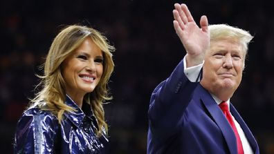 President Trump escorts Melania off the field prior to the College Football Playoff National Championship Game on January 13, 2020.