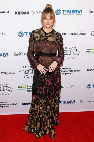 <p>Chrissy hit the red carpet days after announcing her second pregnancy. She wore a stunning patterned maxi dress for the event - the Smithsonian Magazine's 2017 American Ingenuity Awards.</p>