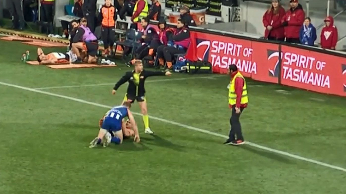 Footage emerges of security guard attempting to break up on-field AFL fight