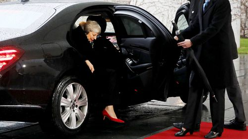 The door of British Prime Minister Theresa May's car is finally unlocked as she arrives to meet German Chancellor Angela Merkel.