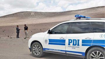 Chilean police near the Atacama Giant.