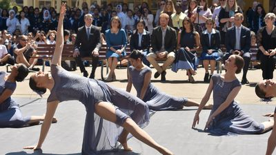 Students perform for royal couple
