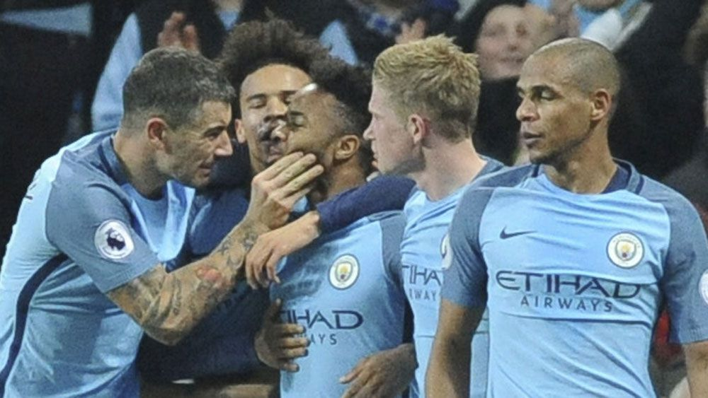 Manchester City beat Arsenal to move into second spot