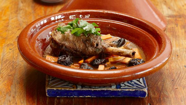 Lamb shank tagine with prunes and carrots, served with steamed couscous