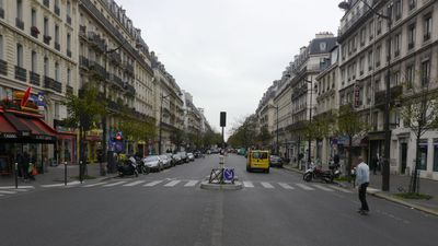 A lone skater rides down the usually bustling Bouldevard Voltare towards the Bataclan theatre. (Jack Hawke, 9News.com.au)