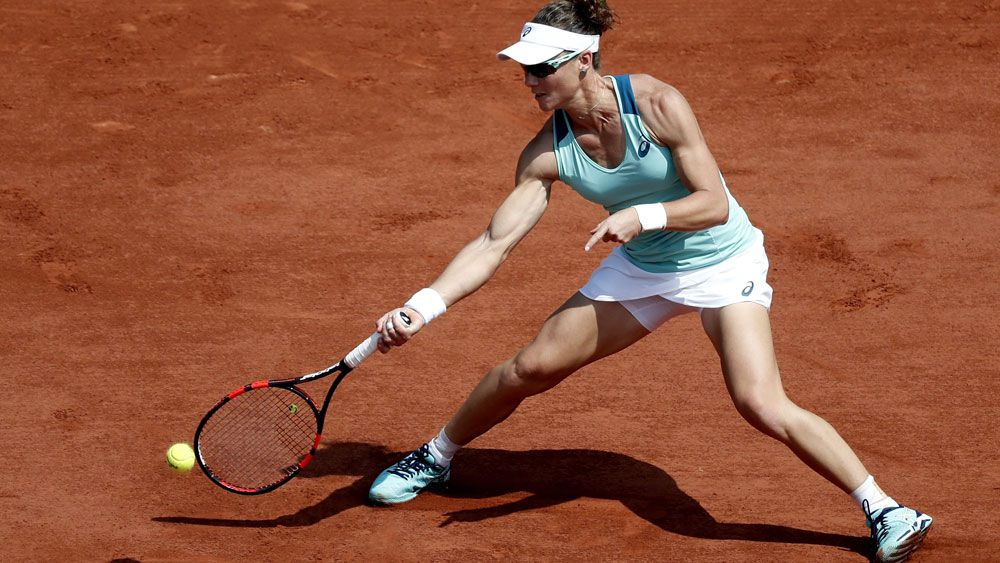 Stosur fights her way to French 4th round