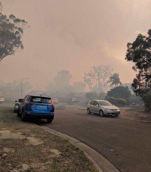 Thick smoke hangs over the streets of south-western Sydney. (Luke Cooper)