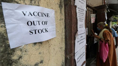 A note informing about the COVID-19 vaccine is seen pasted on a wall of a vaccination centre in Mumbai, India.