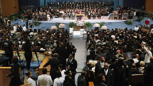 Aretha Franklin has been given one final farewell in a star-studded funeral procession, with her body covered in shimmering fabric in a closed golden casket.