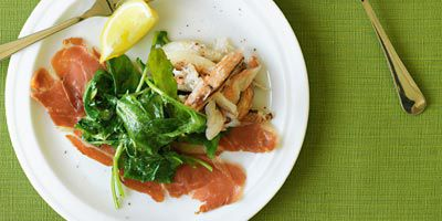 Crab on prosciutto with wilted rocket