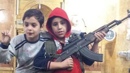 Abdullatif tweeted this image of children posing with an assault rifle. (Supplied)