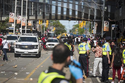 The street was blocked off for a brief period of time. (Tijana Martin/The Canadian Press via AP)