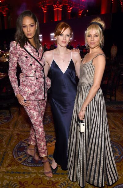 Joan Smalls in Dolce & Gabbana, Karen Elson in La Ligne, and Sienna Miller in Christian Dior at the 20th Annual amfAR Gala