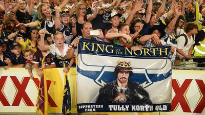 One group of, possibly psychic, fans in the front row brought a large sign naming the night's hero Johnathan Thurston as the 'King of the North', a nod to the popular showGame of Thrones.(AAP)
