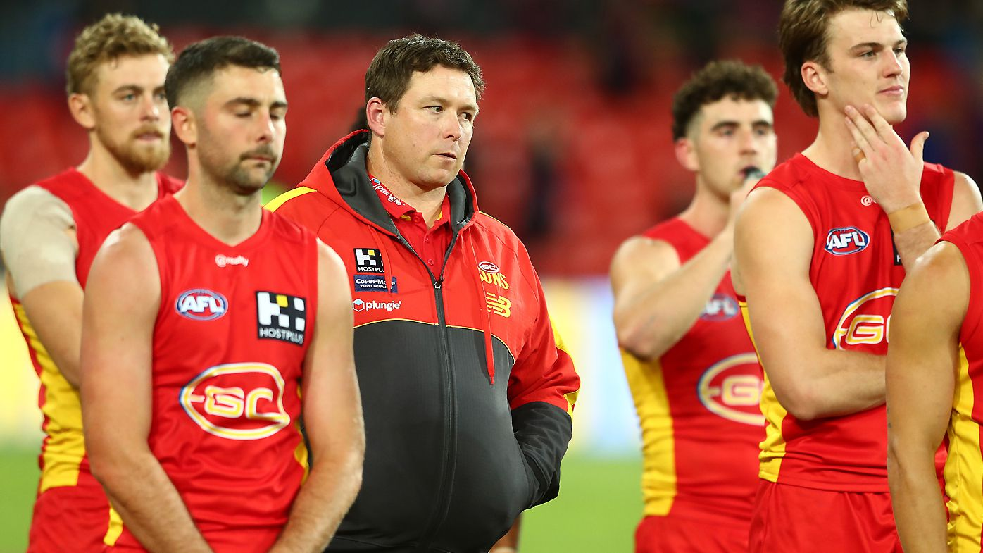Suns coach Stuart Dew and players look on