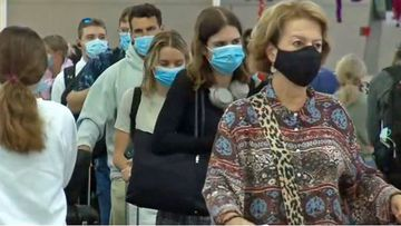Passengers line up for flights home to beat border changes in response to Sydney's Northern Beaches outbreak.