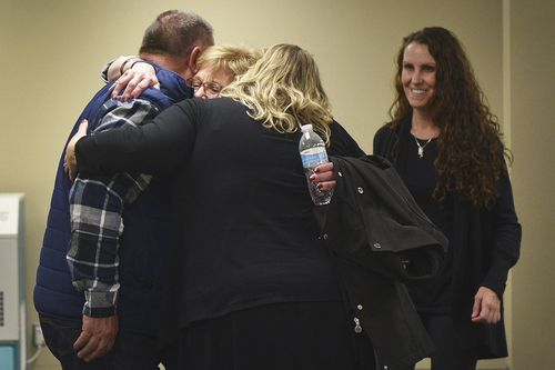 Lynette Johnson hugs friends after the execution is complete in Sioux Falls, South Dakota.