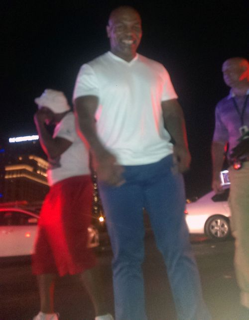 'Just stay down dude': Mike Tyson helps motorbike rider after highway smash