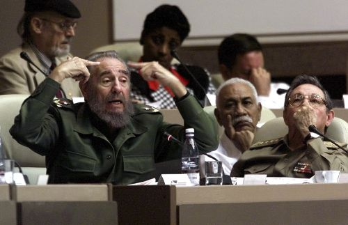 Fidel Castro and his brother Raul in a photo taken in 2011. (AAP)