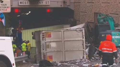 Cardboard was spilled across the road after the crash.