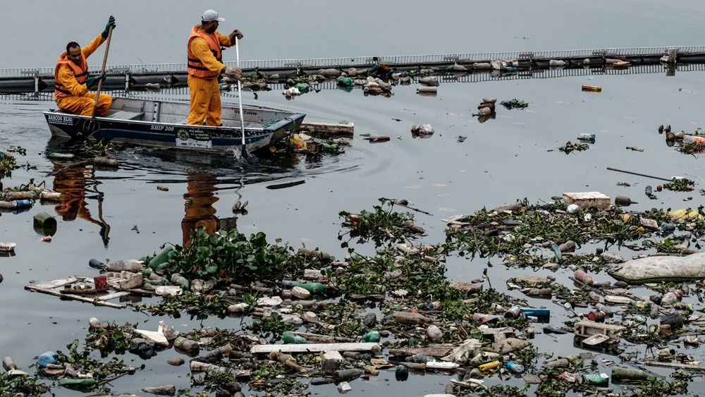 Sailors and windsurfers competing in Guanabara Bay have been warned to keep their mouths shut. (AAP)