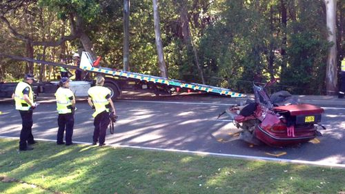 Woman critical after car hits power pole and splits in two on Ferry Road, Southport on the Gold Coast
