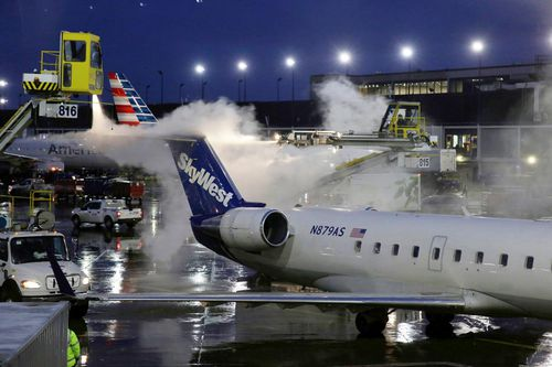 A deicing agent is applied to a SkyWest airplane before its takeoff at O'Hare International Airport in Chicago.