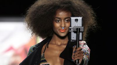 A model taking a selfie on the Desigual runway. (AAP)