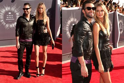 Maroon 5 singer Adam Levine and Victoria's Secret model Behati Prinsloo made their first appearance as husband and wife at the MTV VMAs.<br/><br/>The ultimate rock star couple, these two wore matching leather and complemented each other's looks with Adam's shades and Behati's long, long legs. She's a Be-hottie!