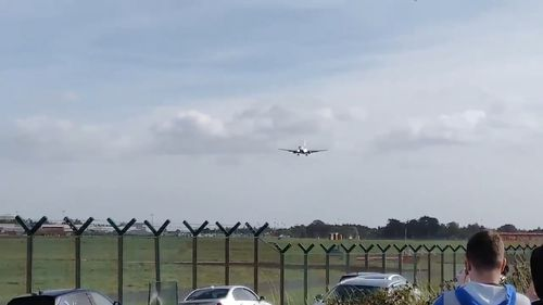 The Ryanair flight from Brussels to Dublin approaches warily in the high winds.