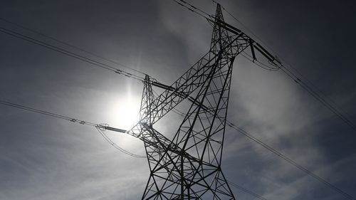 Power prices in Australia are falling after new laws targeted our energy giants.