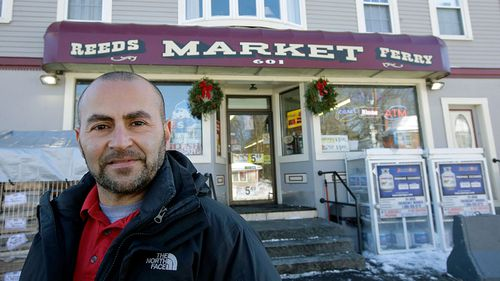 Sam Safa, of owner of Reeds Ferry Market in New Hampshire. A lone Powerball ticket sold at the convenience store matched all six numbers and will claim a $US570 million jackpot. (Photo: AP).