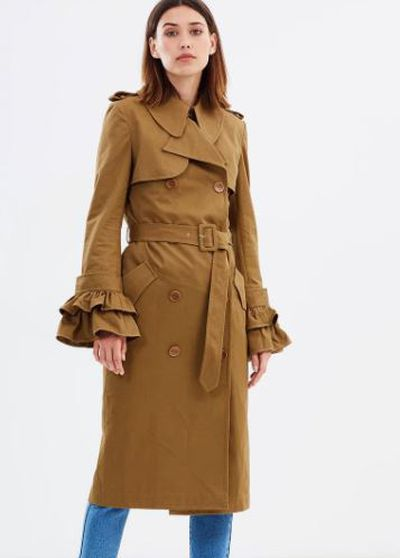"Karen Walker surrealism trench, $925 at <a href=""http://www.theiconic.com.au/surrealism-trench-455759.html"" target=""_blank"">The Iconic</a><br />"