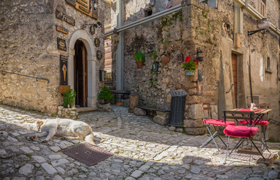 Santo Stefano di Sessanio, Italy. The small and charming medieval stone village, in Gran Sasso National Park, Abruzzo region, at 1250 metres, almost destroyed by an earthquake. Here a view of historic center with an alley in stone