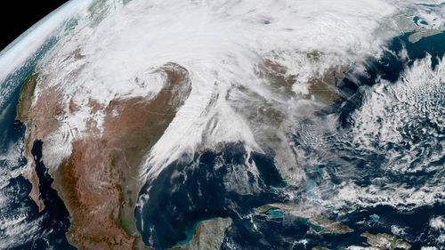 "A handout picture made available by the National Oceanic and Atmospheric Administration (NOAA) winter storm Ulmer becoming a ""bomb cyclone"" over the central US."
