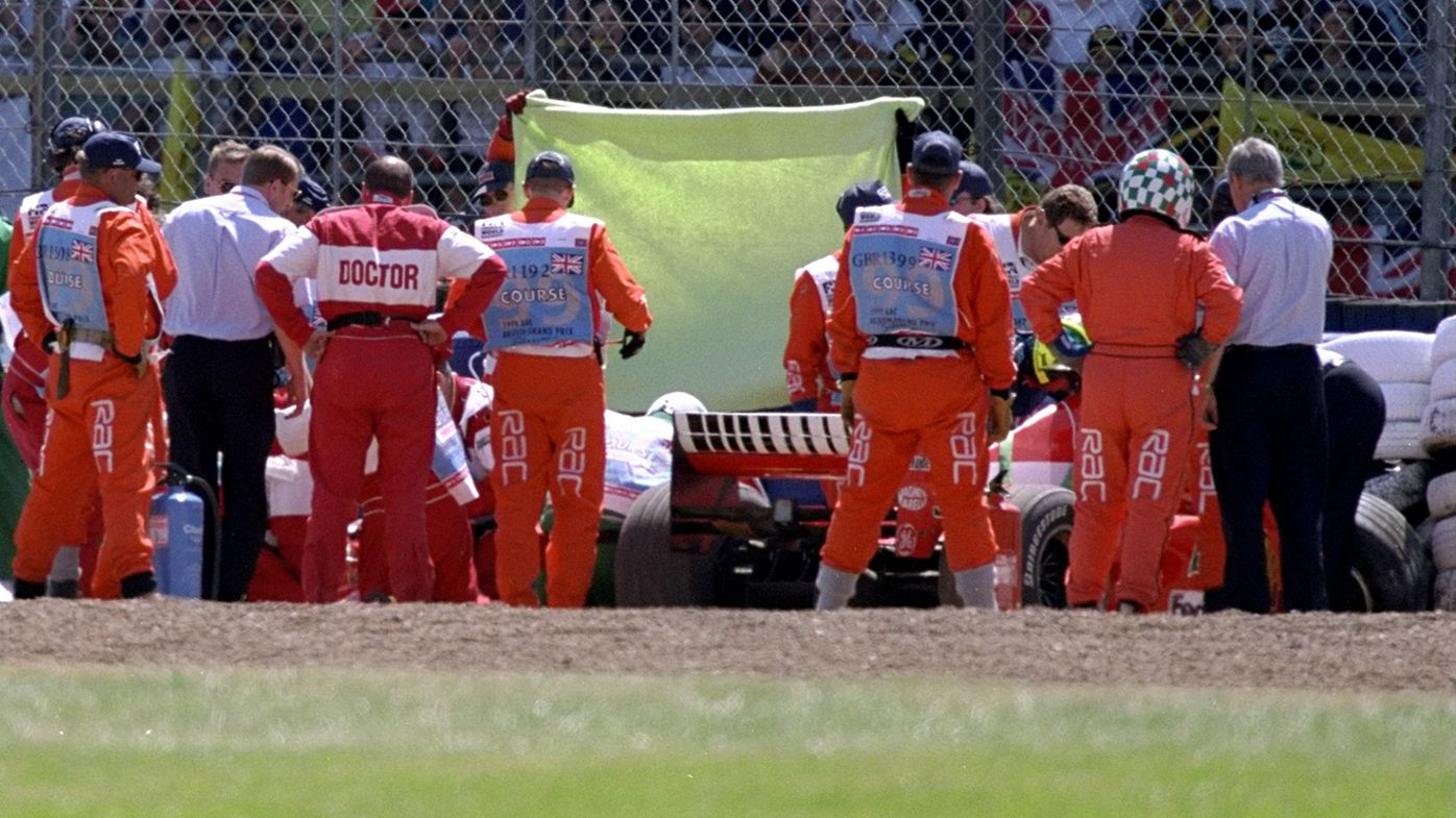 Michael Schumacher is removed from his Ferrari after a huge crash at the 1999 British Grand Prix.