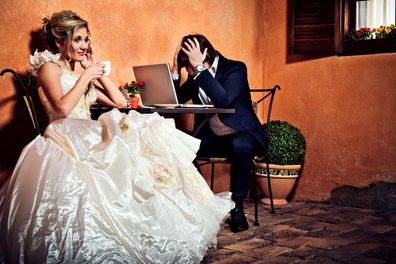 Bride and groom drinking coffee and using laptop