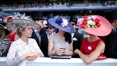 <p>Race-goers show off their hats in the stands on Ladies Day. (AAP) </p>