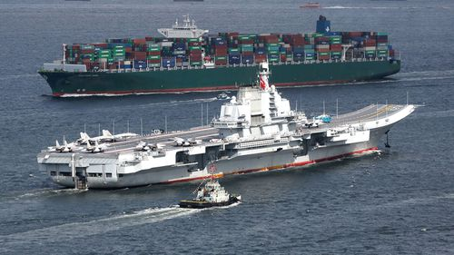 The Liaoning, China's first aircraft carrier, sails into Hong Kong for a port call.